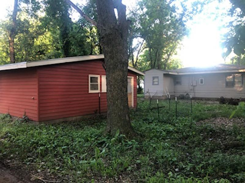 Great Investment Property or Starter Home! 2 bed, 1 bath with large garage. For more information contact Kelly Niemczyk with Prestige Realty & Associates at 785-375-8300.