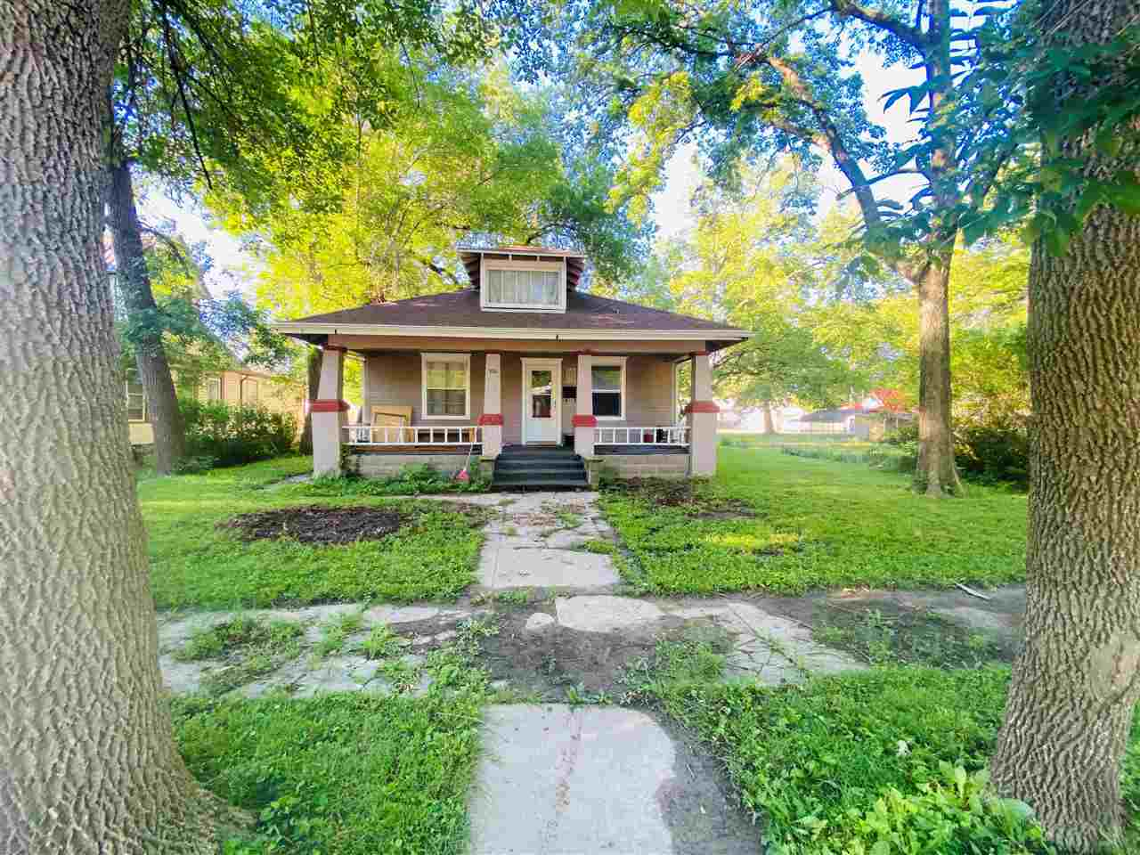 Come and see this charming bungalow on a large shaded lot.  This home features two bedrooms and one bath.  Laundry facilities are located on the main floor right off the kitchen in the enclosed back porch.  Both the heating system and the water heater were replaced in the last 5 years.
