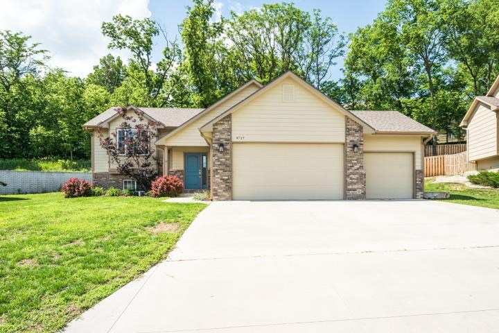 Close to Fort Riley this westside home offers vaulted ceilings, an eat in kitchen, plenty of cabinet and pantry space, full master bathroom and walk in closet. Enjoy the privacy of the wooded lot on the back deck. Fully finished basement provides plenty of space to enjoy and the three car garage has plenty of room for storage!