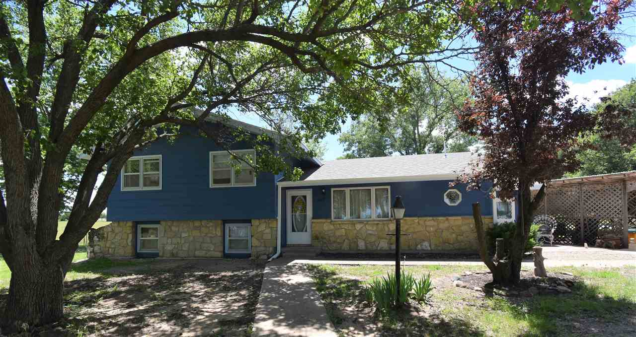 Country home on the edge of Abilene, minutes to Solomon, Salina and Fort Riley.  This is a bi-level home on 1.8 acres.   40 x 30 shop , concrete floor, Camper Pad on the side of the Shop.  Conduit/wiring, box  ready for a 220 outlet.  Open concept on the main level,  sharp kitchen with island/bar, oak cabinetry.  Formal dining area, spacious living room, bath area.    Laundry room is on the main level as well.  Upstairs features 3 bedrooms and full bath.  Lower level has 2 bedrooms, 3rd bedroom was originally a family room with wood burning fireplace, 6th non code bedroom, or open the wall back up for the original family room. Utility room,  large crawl space.  Heritage roof is less than a year old, water heater is 2 years old.  Breezeway to the 49 x 27  -  combo , 2 car garage w/attached shop area, could be used for kids play area, man cave, etc.  Little utility shed, storm shelter, 7 maple,  3 oaks, 5 pines, 1 sycamore, 1 cherry, 2 apricot, & 1 plum TREES!