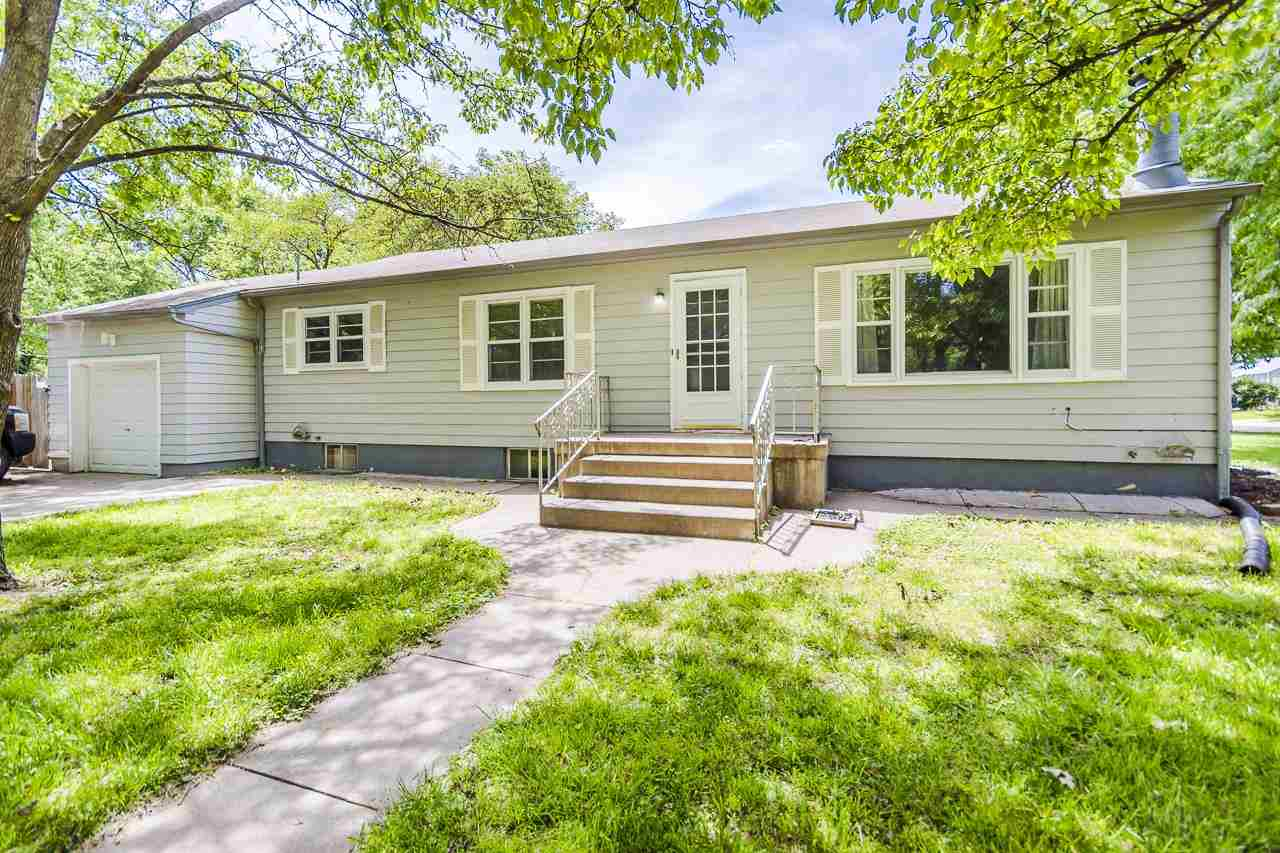 Keep it as a rental or convert it to a single family dwelling.  This is a well kept ranch style home on a good sized corner lot located east of KSU campus and not far from downtown Manhattan.  Close to common playground/park.  Nicely shaded lot with off street parking for occupants and back yard has a privacy fence with storage shed. Main floor offers 3 bedrooms, 1 bath, and large common living area plus a kitchen with eat in options and island.  Basement offers large 2 bedroom apartment with fireplace, full bath, kitchenette, and separate exterior access.  Laundry area is shared by all occupants.  This home would easily convert to a single family residence giving you over 2,600 square feet of living area.