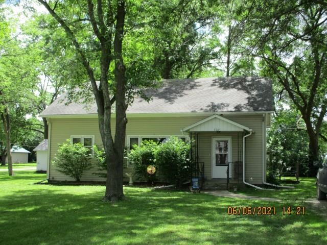 This cute bungalow has 2 bed/1 full bath, and boasts a nice, shady corner lot. An older home with original woodwork, it sits in a cozy neighborhood, making it the perfect spot for someone just starting out as a home owner, or perhaps wanting to downsize. Open dining/living room area, nice sized kitchen, 1 car detached garage. Property is Owner occupied, 24 hr. Notice is required, showings need to be scheduled after 4:30 p.m. thru the week. Property is SELLING AS IS. No additional updates/repairs will be made. Set up your appointment today to see what this home has to offer!! Anita Nittler, Realtor / Lakeside Properties.