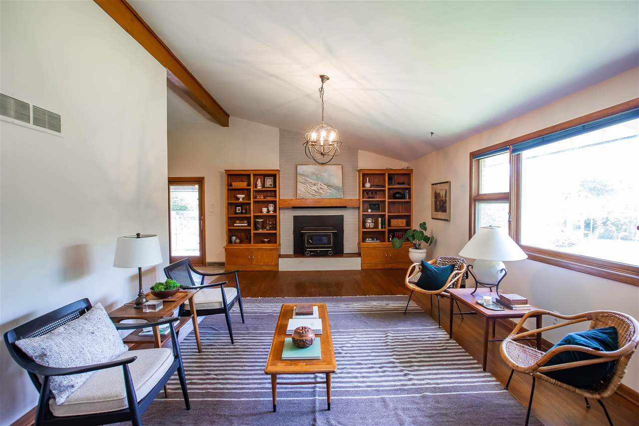 Check out this ranch style home located in the desirable State Streets neighborhood! Mid-century modern vibes with freshly re-finished wood flooring throughout the main floor, vaulted ceilings, wood burning fireplace, updated light fixture in main living spaces, and fresh paint throughout the interior. Roof is less than 6 years old and exterior was painted in the last couple of years. Also, there is a shared well on the property that can be used for watering to save $$ on your water bill! Located on a large corner lot with a private backyard and within walking distance to Marlatt Elementary school. Call Megan Plattner of Alliance Realty today @ 785.285.1317 for a tour!