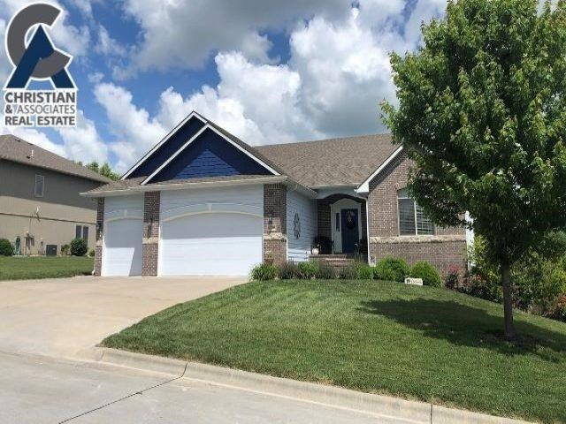 Immaculate custom home with numerous upgrades located in Lee Mill Heights situated on a prime lot with fabulous views! Enjoy the bright and open floor plan with vaulted ceilings, hand scraped wood floors, gorgeous custom built gas fireplace, arched doorways and decorative ledges. Efficient kitchen layout with stainless steel appliances, eat at bar, under-counter lighting, solid surfaces, tile backsplash and walk-in pantry. Enjoy the Kansas evenings on the covered deck or spacious patio below. Master bed and bath feature 2 closets, separate tile shower, dual vanities, jacuzzi tub with convenient access to the laundry off the mudroom and kitchen. Basement walkout boasts 9' ceilings, oversized family room, 2 bedrooms, full bath and an extra bonus bedroom/office. The nook in basement is plumbed for a wet bar. Plenty of space for entertaining. Call Brenda at 785-564-1371 to view this amazing home.