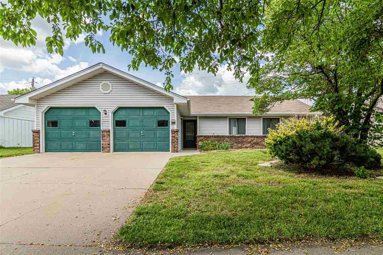 Take a look at this cozy 3 bed, 2 bath, newly remodeled home! After walking past the 2 stall garage area, through the front door you will be welcomed with a well lit, open concept living space. The added entertainment center in the living area makes it an eye catcher with the granite counter tops and shelving space. The large kitchen includes updated cabinets as well as new countertops and back splash. An island with storage, pots rack above, updated gas stove and new hood vents. The 2 full bathrooms have freshly installed tile flooring and new paint to the walls. The Master Bedroom includes hard floors,a double door, spacious walk in closet perfect for a couple. As well as access to the Master Bath. Bedroom number 2 also has hard floors and a walk in closet! The 3rd room would be great as an office area with closet space as well. For more information or to schedule a private tour call/text Bryan at 785-614-3648