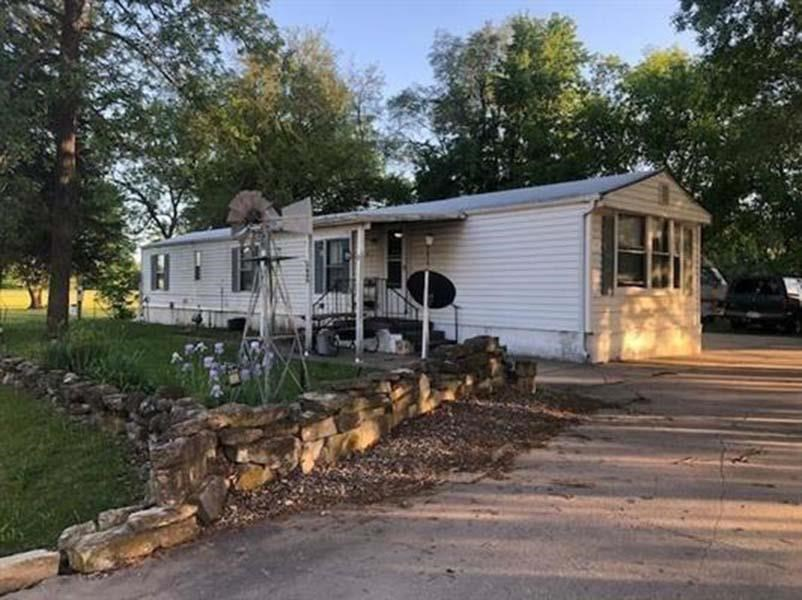 Lots of potential with this 2 bedroom on a large lot with plenty of parking. This home is located close to Post and right next to the Ogden Park. New flooring, and other improvements have been made. Great price and location.