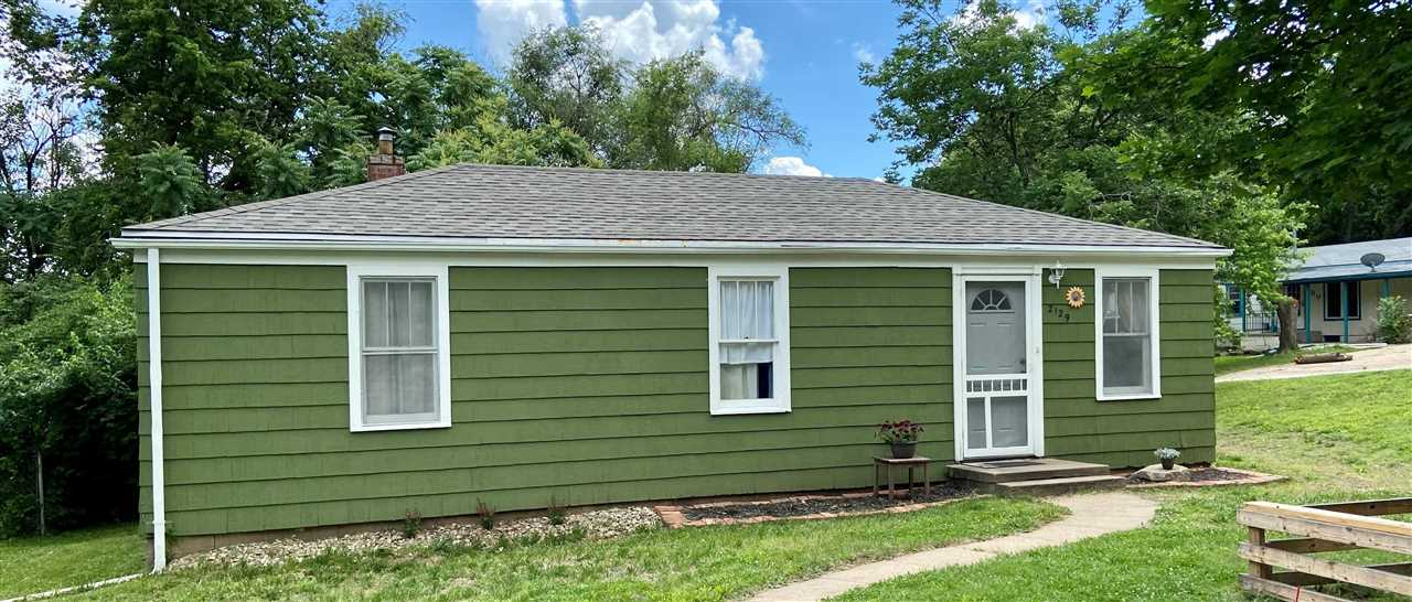 Cozy home centrally located in Manhattan! Enjoy quick access to campus, Ft. Riley, and downtown Manhattan. Nice updates including a new roof, paint, fencing, landscaping, and more. Find two bedrooms and one full bathroom, beautiful wood floors, and an open dining/living room in the home. Sitting on a corner lot, it has a detached garage and fenced-in back yard for the kids to play. Come take a look today!