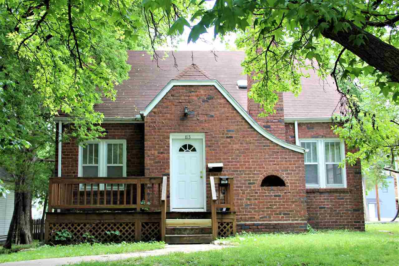 All brick home close to Aggieville, KSU, Bluemont grade school, shopping.  Currently vacant but signed a years lease starting 8/1/2021 for $1400.00 a year and the garage is rented separately for $175.00 month to month.  There is a second kitchen in the basement.  New carpet in basement, hardwood floors on the main.