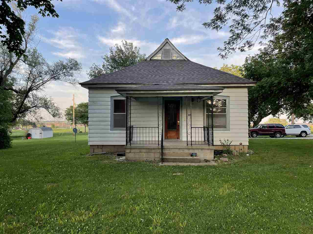Located on the edge of town, this bungalow is full of character! With a recently updated kitchen and beautiful wood floors throughout, this 2 bedroom, 1 bath home is just what you are looking for! There is also a nice sized two car garage, and tons of yard space. Call Megan today at 785-562-7032 for your tour!