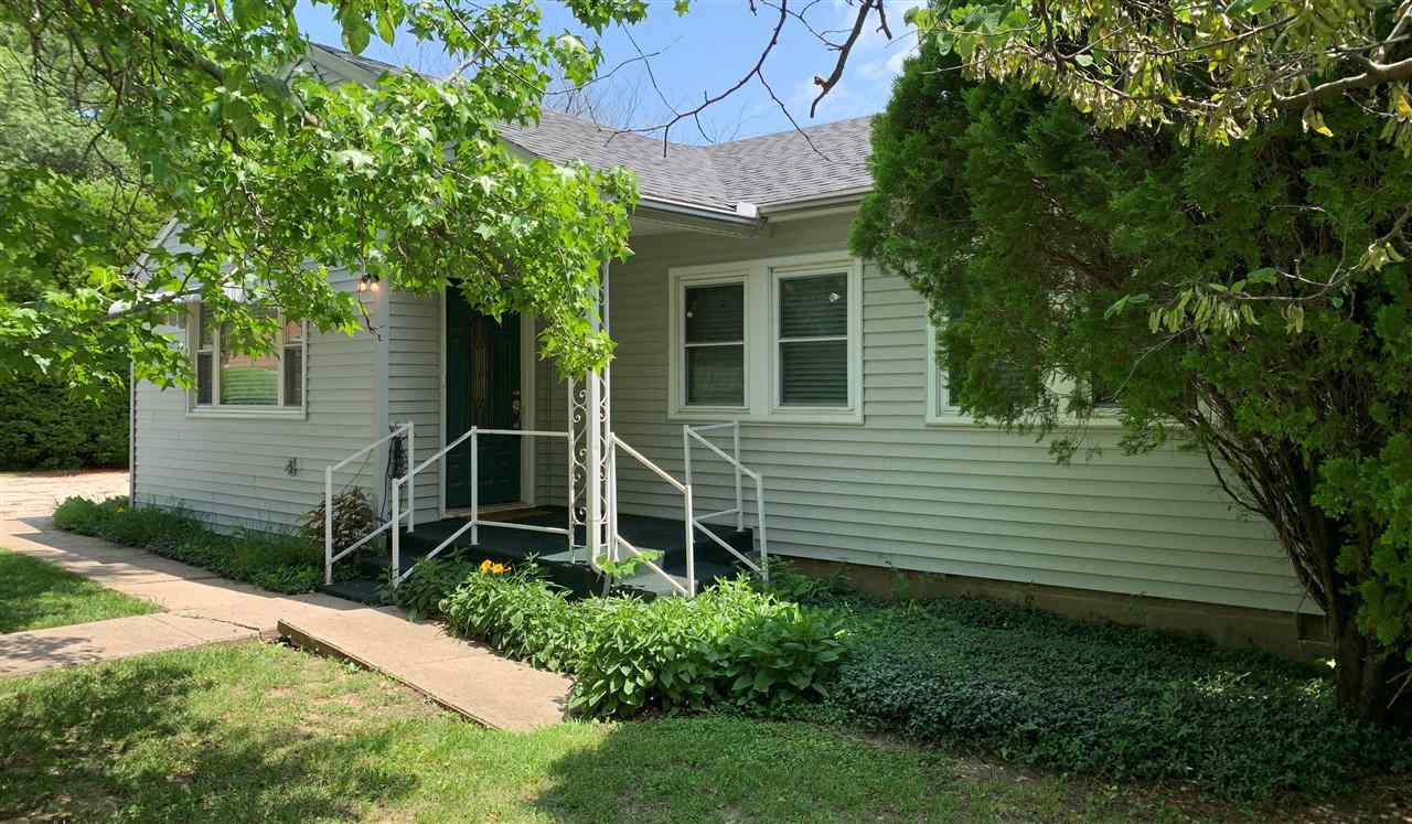 Nicely maintained, one-level ranch home with large garage! Lots to love with three to four bedrooms, two bathrooms, kitchen with new countertops that walks out to the deck, grand living room and more. The oversized two-car garage has just over 1,100 sq ft altogether for storage or tinkering. There is even an additional storage shed that was previously used as a separate workshop. New roof on the house and garage last year! Give the Lakeside Properties office a call to take a look - (620) 767-5045