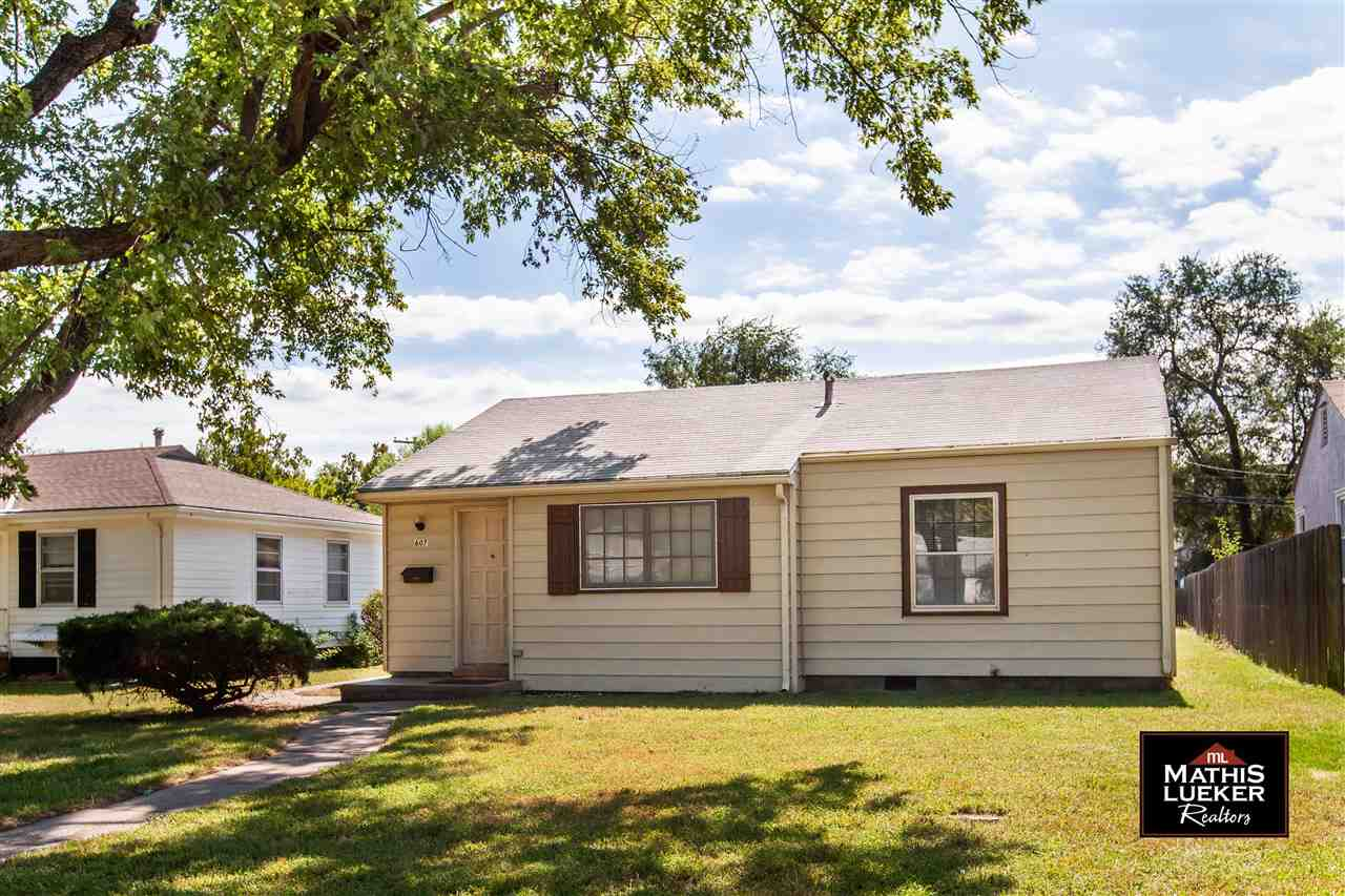 Another great listing by Trish @ Mathis Lueker Real Estate, call/text 785-761-7653.  Darling and affordable one story home in a nice established neighborhood would be a great property for an investor or owner occupant. Two bedrooms. One BR has beautiful wood floors and the other is carpeted. 1 bathroom. There are two living spaces in this home--a formal living room and a cozy family room with a wood burning fireplace. Single car attached garage has plenty of room at 308 square feet.