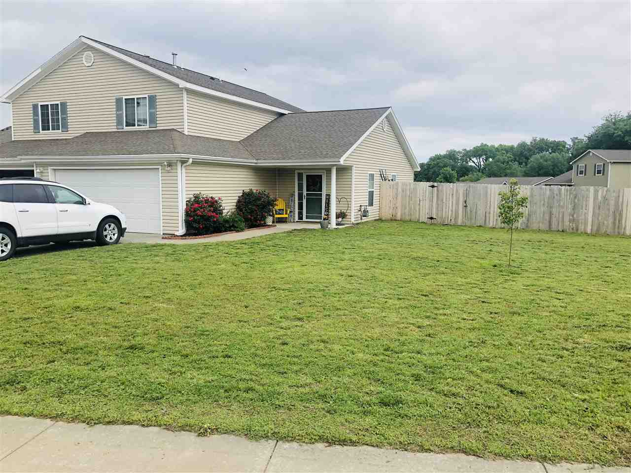 Location is key and this home is it! Quick commute to Fort Riley as well as K-state and downtown Manhattan.  Open floor plan with Master bath and walk-in closet. Laundry is on main floor which is a huge plus. Kitchen has rustic alder cabinetry with black appliances. Lot is AMAZING - large corner lot with wood privacy fence.  Ready to close quick and move in. Call Margaret Johnson with Realty Executives for a private showing 785-307-1714