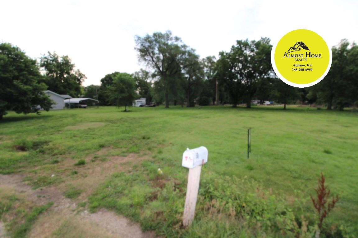 Looking to build in a smaller community? Take a look at this great piece of property. It is 2.5 lots measuring 125 x 150. Plenty of room for a house and shop.  All of the utilities are on site and there is alley access. Located on the West side of town. Less than 15 minute drive to Abilene or Salina. Easy access to Old 40 or I-70. Zoned to be built on. Give Shelly with Almost Home Realty a call today to set up your showing 785.263.5028.