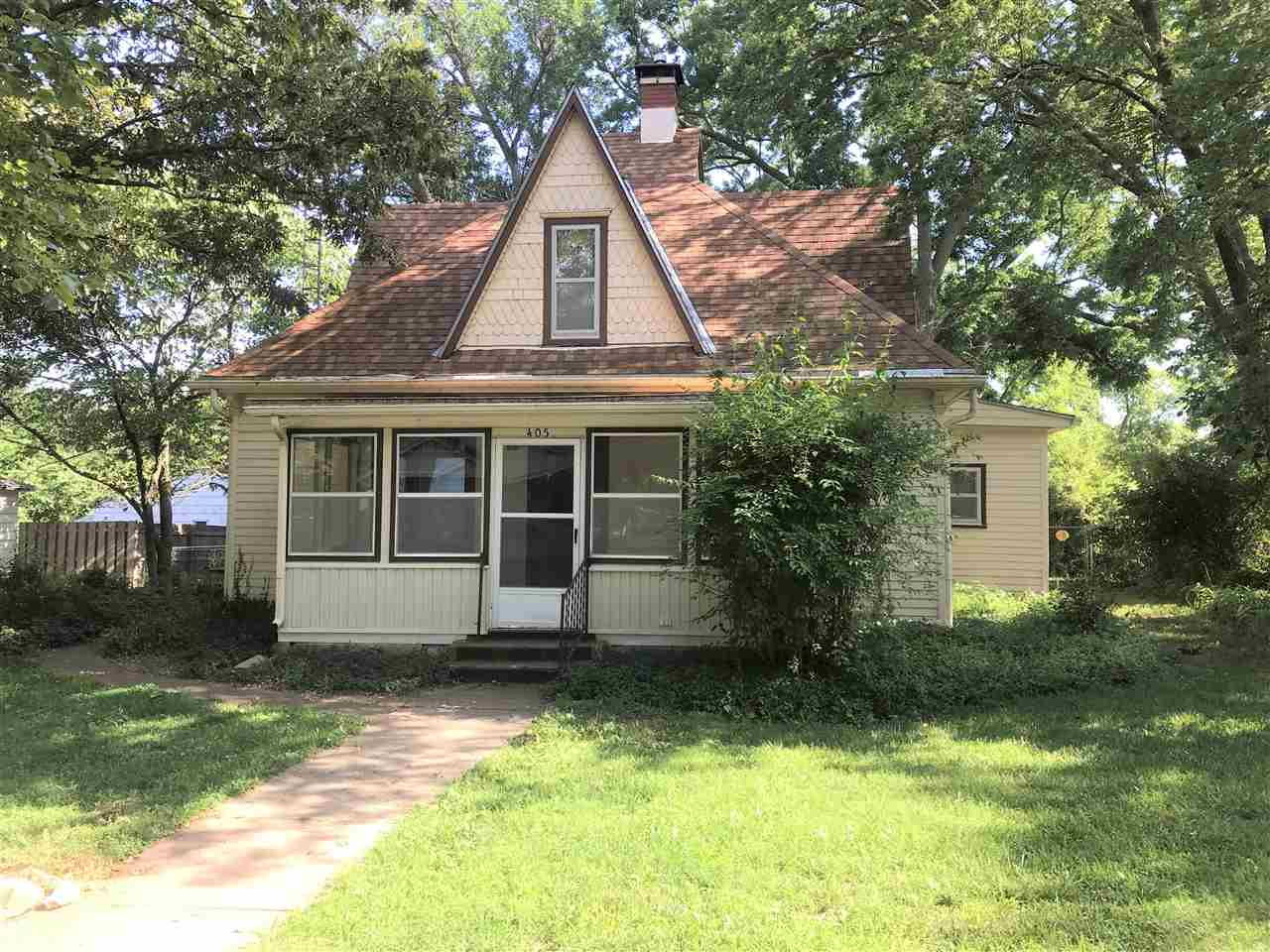 With charming features and extra space, this home has a lot to offer. There is an open floorplan from the living room to eat-in kitchen and original woodwork throughout the home. There are two bedrooms on the main level with 1.5 baths, office and bonus room. The yard is child and pet friendly with established trees and a full fence. Comes with all kitchen appliances. HVAC is newer. There is a two-car detached garage with lean-to space for additional parking. The garage is set up with electric for a welding or woodworking shop. The home is being sold with an additional portion of the lot behind it which contains a shed. Easy drive to Fort Riley! Call Abby Anderes with Kansas Best Realty for a showing 785.479.3983.