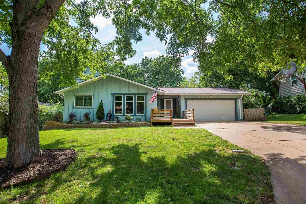 There is always a comfortable feeling in Warner Park and this home is at the top of it all. The neighborhood offers nature trails, picnic shelters, and a disc golf course.  If you like Target, get excited because it is just down the hill. This home is on an established site with mature trees, and plenty of room to run, play and shoot hoops! The home's location cannot be beat with prime proximity to Ft. Riley, Stagg Hill Golf Course, all of MHK's amenities and schools with the bus stopping on the nearby corner.  Lovingly cared for over the years.  Newer roof and windows! Freshly painted interior updated flooring and a modernized kitchen.  Choose to unwind in the spacious main living room or lower-level family room with fireplace. Walkout basement and large two-car garage. Quick possession before school starts is available & ZERO special assessment taxes!