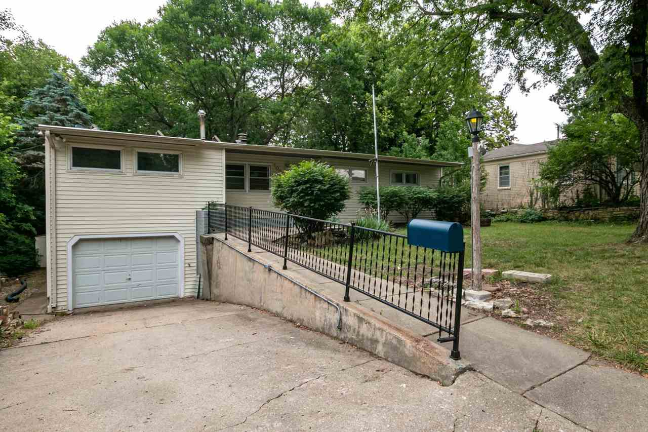 GREAT OPPORTUNITY! NEW ROOF! Located in the heart of Manhattan, you are just minutes from downtown, and close to KSU campus. With great bones there is tons of potential for any home owner. The county counts this home as 2 residents, which gives you the opportunity to have a mother-in law apartment. The back and front yards offer the perfect landscape for any type of gardener. With a treed scenery and a small running creek, this backyard is one of the most unique backdrops. Don't miss the potential of this home by calling David Renberg 785-236-9438!