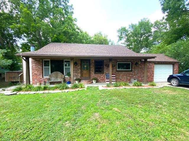 Very charming ranch home. Great for a family or if you are wanting to down size. With an open kitchen to the living room, 3 nice, sized,  bedrooms, 1 and a 1/2 bath, full basement, on a large double lot. Enjoy a large, shaded deck. The yard is fenced in, ready for kids and/or pets.  Located in nice neighborhood. The full basement offers room to grow and expand your living space. The wood burning fire place give a cozy place to warm up in the winter. Mature trees give cooling shade in the summer.  Make an appointment to see this charming home.         Denise Hartman 620-767-2863