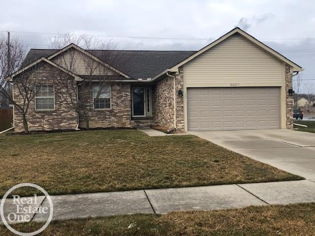 Ideal ranch offering open layout & 2.5 baths on a large corner lot.  Great room with cathedral ceiling, fireplace w/windows on either side, recessed lighting, master suite w/private bath & walk-in closet, 1st floor laundry w/washer & dryer, oak cabinets, stove, fridge, dishwasher & microwave,  bay-doorwall leads to a private deck & fenced yard. Unfinished basement w/glass block windows, newer hot water tank, additional utility sink in  bsmt, inground sprinklers, close to Great Oaks Elementary.