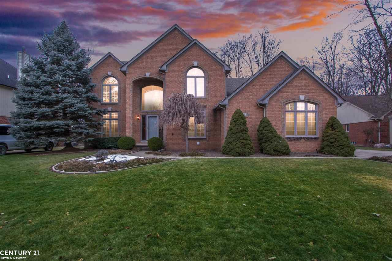 Don't miss this gorgeous colonial nestled on a premium wooded lot on a quiet cul de sac street. Enter thru the impressive hardwood foyer opening to a formal living and dining rooms. Double french doors to large den or office. Beautiful kitchen with gleaming ceramic floors premium white cabinets and granite counters. Upgraded stainless appliances. Spacious great room with stunning gas fireplace & mantel. convenient first floor laundry room and powder room. Upper level features 4 large bedrooms, master retreat with full bath & relaxing jetted tub plus separate shower, loft overlooking the great room makes a perfect study computer area. Beautifully finished bsmt w/kitchen, full bath & separate work room. Situated on a well landscaped wooded lot w/paver patio & 3 car garage, in prestigious Vineyards sub w/common areas & creek. Close to shopping, entertainment, transportation. New roof 5yrs, new furnace 2-3yr, Award winning Utica schools.