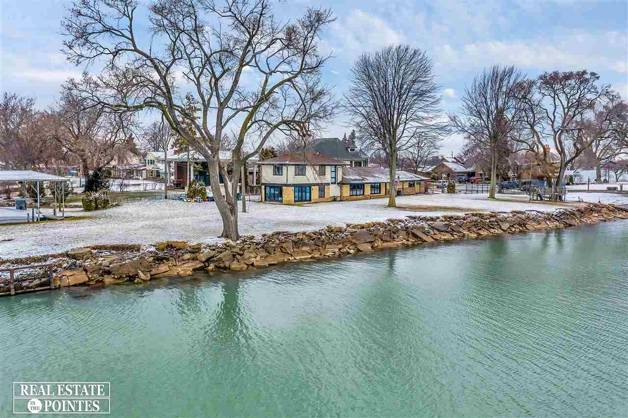 This is once in a lifetime opportunity. Breathtaking gated completely remodeled / open concept home at the end of a quite dead end street. Enjoy the Sunrise & Sunsets of Lake St.  Clair. Porcelain tile throughout the  Living space, dining room & kitchen, Custom wood Cabinetry, GE Monogram appliance's, 14 ft. Island w/ Mont trinity quartz counter top & back splash. Vaulted ceilings w/ custom moldings, Nuheat heated flooring. Perfect floor plan for entertaining  at a Lake Housel. Enjoy looking out the Family rooms brand new Anderson door walls either to the Lake or canal view. Nuheat floors and indoor outdoor speakers, crown moldings, Pottery barn light fixtures. Master suite spares no expense, Hw flooring, Nuheat heated bathroom flooring. Neorest Toto toilets, Custom Jalco oversized shower head, shower jets,custom cabinetry w/ Granite counter tops. Bd #3 & 4 Hw floors , custom closet connection closets,  Gym or Home office. 2nd floor enjoy the beautiful view. All glass garage door 2/21
