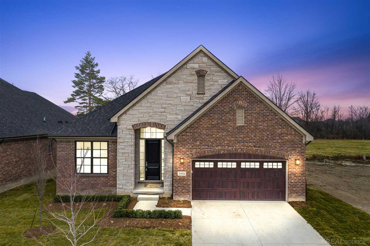 """HOME IS BUILT AND COMPLETE IN 60 DAYS!. Luxe MAINTENANCE-FREE community features Carefree one-level lifestyle. Designed by architect Martini-Samartino Design- truly an open-concept. Stunning all brick elevation w/limestone accents, dimensional roof, 8' front door & rear Loggia w/TREX deck! Interior features inc: Foyer w/12' ceiling height, open staircase to LL w/iron spindles & crown moldings. Gourmet kitchen boasts shaker cabinetry w/42"""" uppers, soft touch close doors, LG/center island, Quartz counters, pantry & opens to Great Rm w/ FP, step ceiling, crown molding & Nook w/oversized doorwall. Master Suite w/step up ceiling & Bath w/LG private shower, euro door, vanity w/2 sinks, water closet. Hardwood flooring, extensive trim, & light fixtures inc. Your lot overlooks open field- private. Trex deck/covered porch, LANDSCAPING, SOD & SPRINKLERS INC! LAWNCARE & SNOW REMOVAL INC!"""