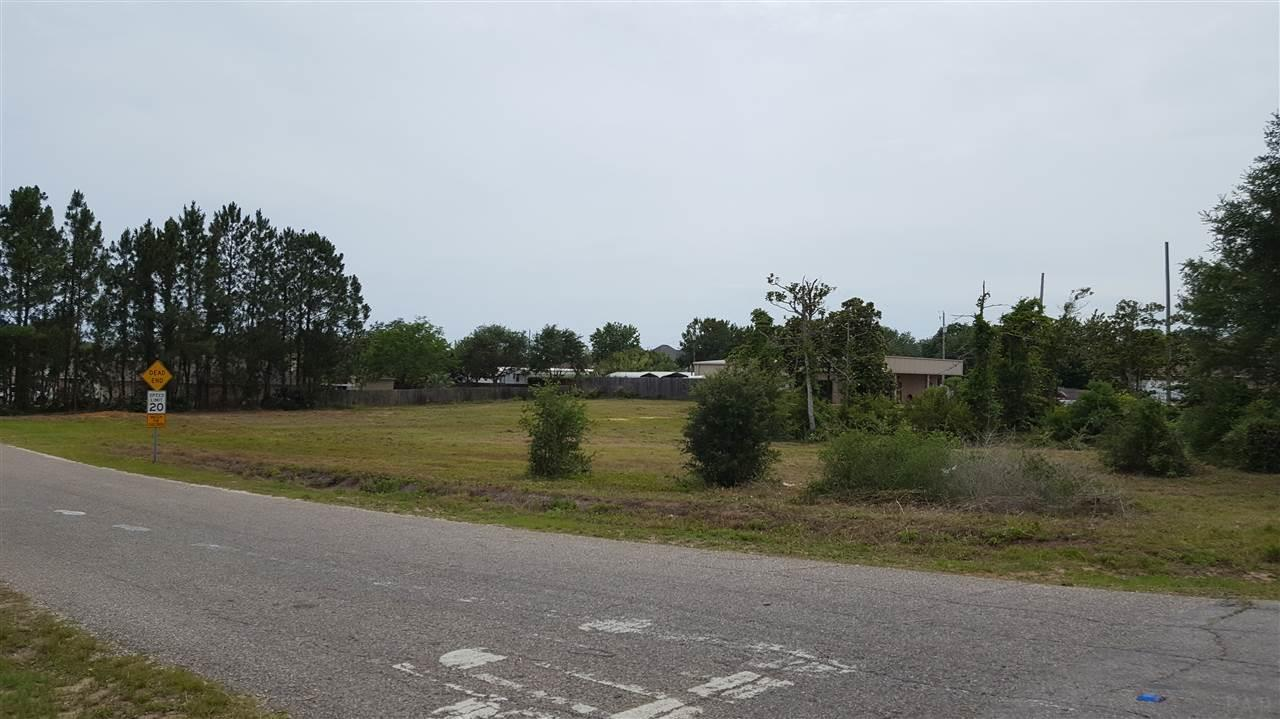 New Lower Price for this Great High and Dry corner lot near high producing Whataburger Restaurant and soon to be Wal-Mart Market Shop Grocery Store in Navarre! Owner is serious about Selling Now and will even consider Financing! This property has maximum exposure for a business, fast food service, restaurant or retail strip center. The front 200 ft of depth is zoned HCD (Highway Commercial Development). The rear 70 ft is zoned residential R1 which can be used for holding ponds and possible parking. Conditional use variance possible with different needs. See the Aerial View Here https://goo.gl/Smaqvv