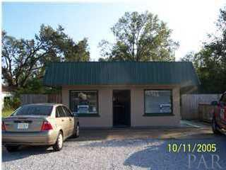 330' +/- OF ROAD FRONTAGE ON HWY 90. LOT CONTAINS ONE BUILDING, REMAINDER OF PROPERTY IS WOODED.