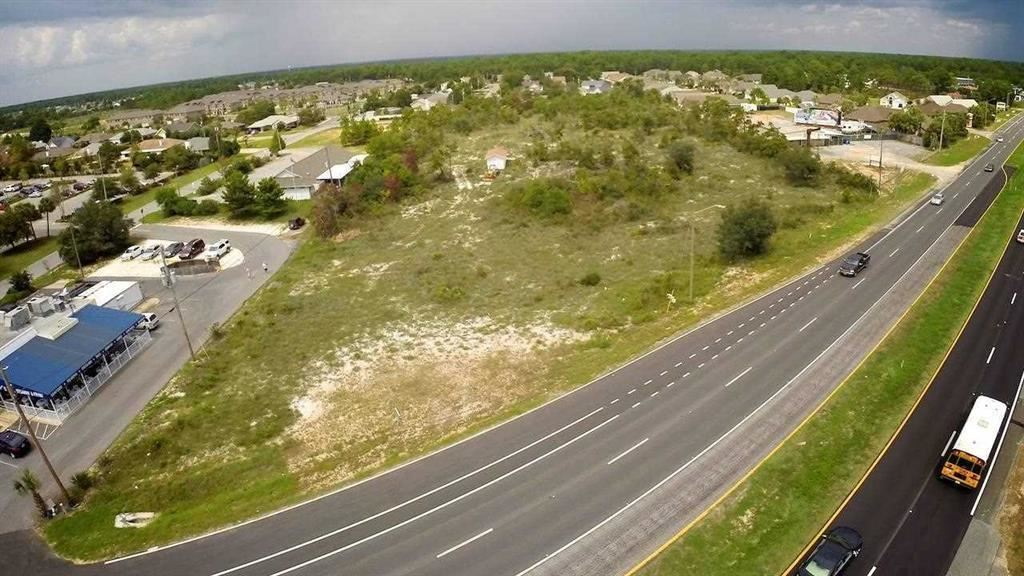 5.137 acres on Hwy 98 - zoned HCD Great property close to Navarre Beach and the Hwy 87 intersection, as well as the Navarre Beach bridge. It is located on busy Hwy 98 with easy access from Hwy 98 as well as a rear entrance to property. This is one of the few symmetrically shaped, large tracts in the Navarre commercial district. Property is comprised of mostly sand, scrub oaks and palmetto bushes.