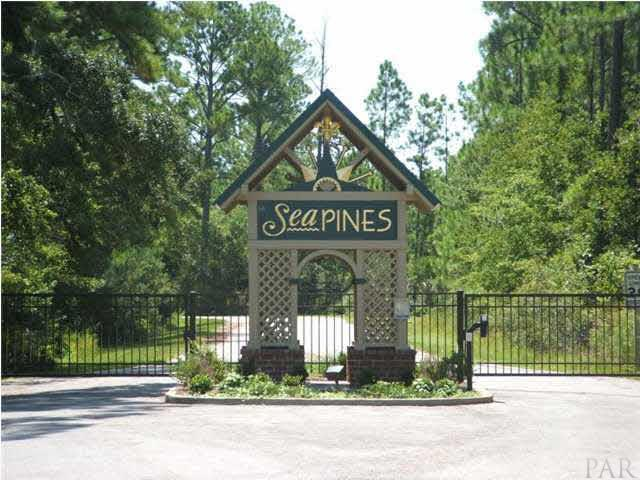 Interior lot in un-gated part of Sea Pines Subdivision. Community shares beach on East Bay, Gazebo, 7 acre Lake. Sewer available, no septic tanks. Association dues $350/year.