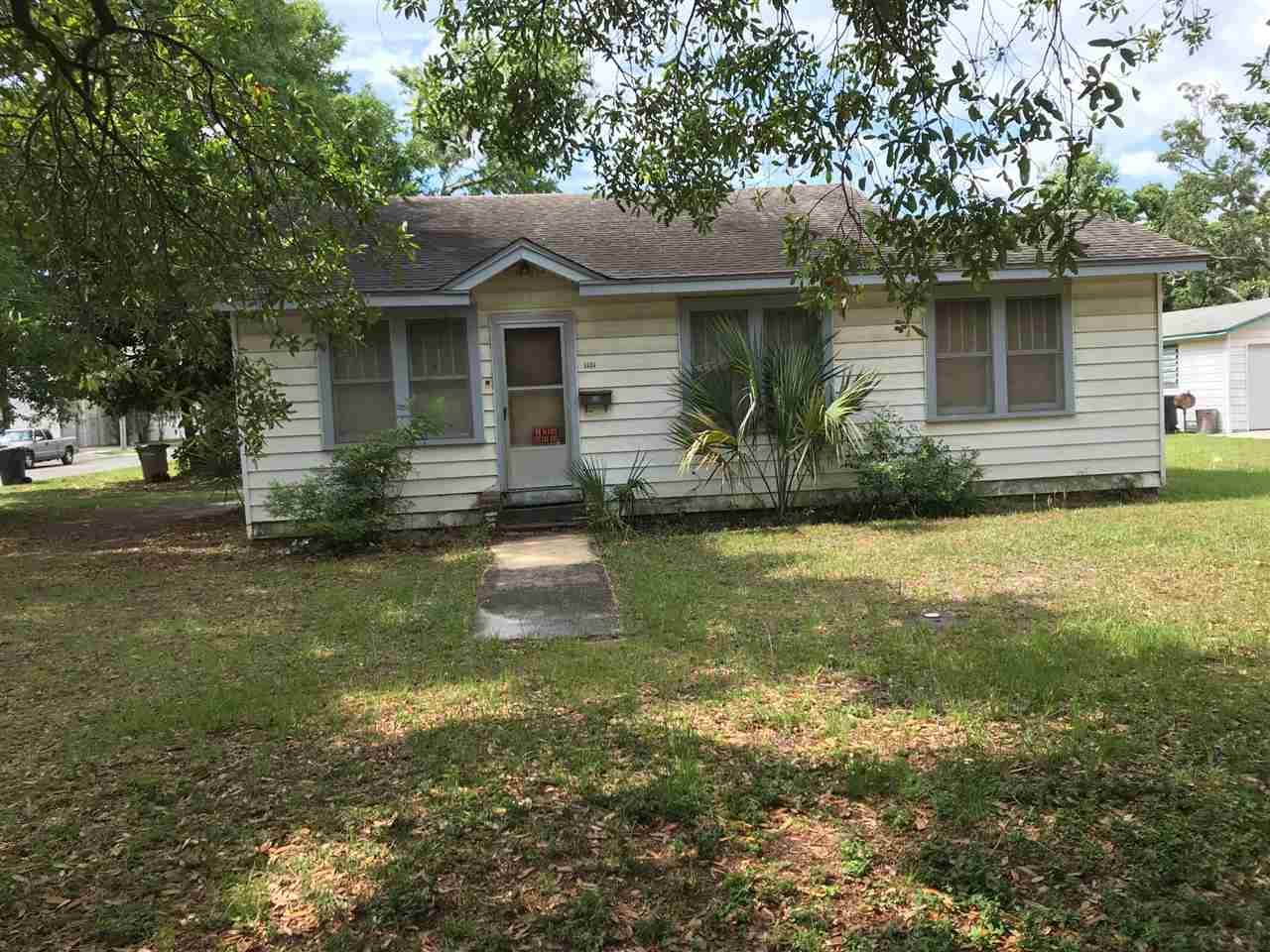 This small solid cottage has tongue and groove ceilings and floors in main living area. It has been owned by a well known shrimp family for 33 years, and rented to same tenant for 20 years.   Would be good rental Or tear down to develop land.  Land is 90 ' on Gimble and 125'  on S. D Street.  The land value justifies the price with .258 acres (11,238 sq. ft.) room for 3 lots/homes for developing.  The roof was replaced after Ivan in 2005.  This home needs some work such as new windows, kitchen upgrades and new window A/C units.   The tenant is removing the 2 window units so new ones need to be added.  There is a nice attached storage.  It is located two blocks from Joe Pattis and four blocks from the water. Only minutes walk away from the Maritime Park and the heart of downtown, this location is ideal for somebody looking for the downtown experience for a low price.  Call Sharon for easy show 341-1648 or 477-7050.  Showings 1-5:30pm.M-F.