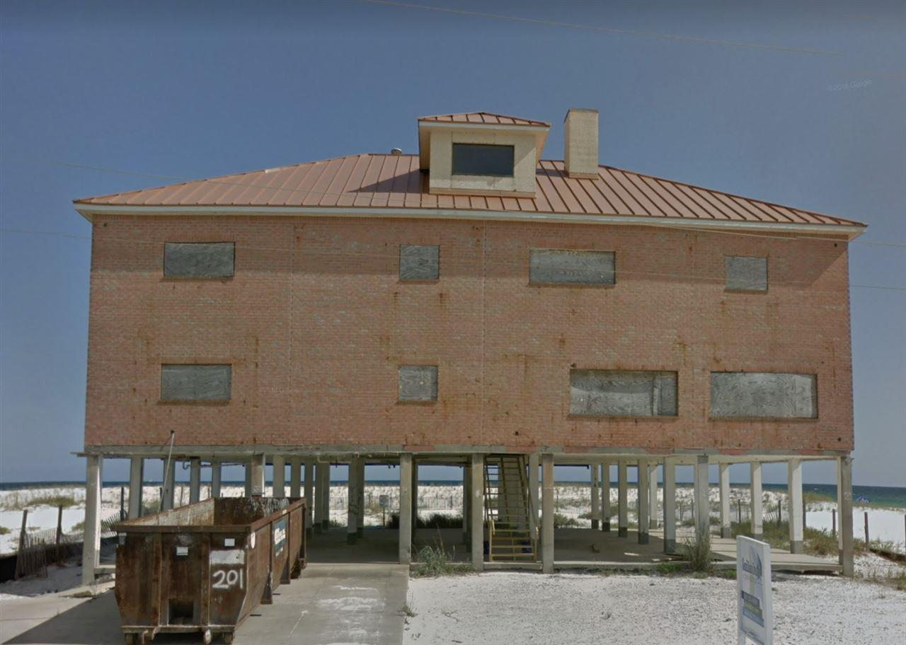 """Rare opportunity to acquire the most Iconic home on Navarre Beach.  This large 6,750 square foot home offers 5 bedrooms and 3.5 bathrooms in its current configuration.  It was last sold in 2003 for $2.2M and was damaged during hurricane Ivan in 2004.  The home's interior was stripped down to the stud walls and a new metal roof was installed.  This property has amazing potential as a vacation rental, event venue as it features 10 miles of vacant white sugar sand beach as your private""""back yard"""". This home is a blank pallet and allows for you to redesign the interior space to meet your needs.  This is a full renovation project property."""