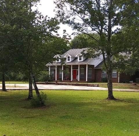 Quiet peaceful living on gated 2.5 acres fenced, solid all brick home, 4 Stale horse Barn and Pool with new liner and pump. This Milton home is minutes from Interstate 10 located off Exit 28 just 2 miles North.  It is 25 minutes from the Pensacola area, Pace and Gulf Breeze!  The nice barn is spacious with a new roof, partial electric fence, partially cleared property, fenced area for gardening.  Current owner has raised horses on this land for years and its well maintained.  This solid 3 bedroom home has a master suite with walk in closets, garden tub, double vanities, sep. shower and glass block. The other two rooms share a full size bath with tub.  The half bath is off the kitchen as you exit to 2 car garage. The Florida room faces the barn, high 9.7 ceilings in living/dining combo area.  Kitchen has eat in island and 4 burner stove/oven with down draft.  Natural lighting at the bay window in the kitchen. Large walk-in laundry room with new cabinets can also be used as a mud room.  The circular driveway is fairly new and the home has 4 video cameras w/ hard drive to TV around property, new pool liner 2019, gutters, and new architectural roof installed Oct. 2004. Property never flooded.  This is a gardeners dream and animal lovers paradise and perfect for having horses in your own backyard.!  A garden area is already fenced off the back deck as well as the fenced pool.  Imagine watching your horses after a day of gardening as you're relaxing in your pool!    This is a dream come true for the farmer in all of us especially for raising and having livestock.   Blueberry bushes all over the property! 10 Minutes from Downtown Milton and 20 minutes from hospitals. The house is in good condition and has been well cared for and enjoyed!  Call today for a showing! You will be glad you did!