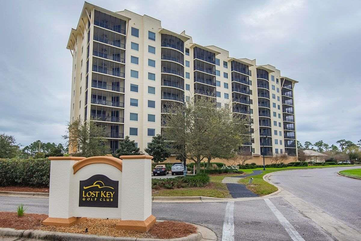 """You have just FOUND the KEY to a great buy in LOST KEY!! This is a lovely 3 bed 2 bath end unit in the NEWEST TOWER of LOST KEY GOLF AND BEACH CLUB, Unit 606!  San Anton..a lovely Corner Unit has a phenomenal view of the Intercoastal Waterway (ICW) AND the PAR 71 signature Arnold Palmer designed GOLF COURSE which is also a Certified Signature Audubon International Sanctuary. The San Anton tower is the closest to the Lost Key Golf Club,across from Great menu/ Bar at Clubhouse The unit has been professionally cleaned to incl.carpets, drawers, appliances, baseboards.  It is priced to sell and move in ready! This 3/2 unit has an owner with good taste making many upgrades costing approx. $12,000 at the time of construction. Wonderful open floor plan living, dining and kitchen combo with massive views from all angles. Views from the balcony/living ofICW,marina, golf course and club house. Upgrades include: Shaw Carpet in all bedrooms, ceramic tile, upgraded Waverly maple cabinets in kitchen and baths, all Sherwin Williams paint, satin nickel door hardware and polished brushed chrome in kitichen, """"leather"""" granite in kitchen, white Kohler ceramic sink and all Whirlpool black on black appliances. The master bath has jacuzzi soaker tub, separate showers and dual vanities. High end $4,500 plantation blinds and window coverings only three years old throughout entire condo. This condo includes one of the limited designated covered parking spots just steps away from the spectacular ground floor lobby, which is secured. Outdoor cooking area included in common space at pool. Ready for a new owner and a wonderful lifestyle on the beautiful Perdido Key! As a owner, the gulf front Beach Club of Lost Key provide beach access, dining and pool via well-managed, air conditioned shuttle service.  If you rent the unit long term the tenant also has access to clubs. Minimum rental term is 6 Months! As a LONG TERM RENTAL pricing is upward of$1,700/month. This unit is calling your name!!!"""