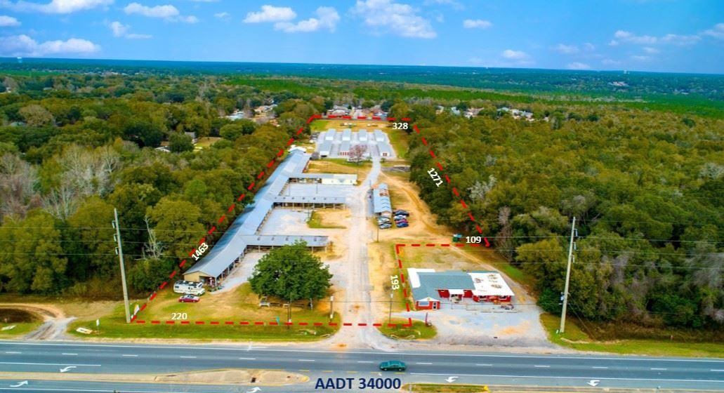 Joint Venture Redevelopment Opportunity.  2 parcels including 5186 and 5200 totaling +/-11.11 acres with 324 ft of US-90 road frontage available.  Owner will sell 5186 US 90 totaling +/-10.65 acres with 224 ft of US-90 road frontage.  Property is zoned HCD and is located directly across from Lowes and the new IHop and Sonny's BBQ.  Value is based upon the land and not the existing structures.  Financials for existing can be provided with executed CA. Improvements to the property were completed in 2002 with the addition of the 8 mini warehouses.  Each mini warehouse is a total of 3200 square feet separated from the Flea Market by a 6 ft. security fence.  The 183 storage units include 79 - 10x20 units, 88 - 10x10 units, and 16 - 5x10 units  The Mini Storage Units have electrical conduit run for lighting and additional improvements of gutters, fire extinguishers, fire hydrant and gravel drive throughout. 1.86 acres of cleared land enclosed within the 6 ft privacy fence in the rear for additional improvements if desired.  Currently it is income producing as yard storage by the foot.  The Flea Market includes 74 total units with additional income produced by Table Units rented per day and 2 vending machines on the grounds.  The Market Antiques has a new roof which was placed on the Retail Shop in January of 2019.