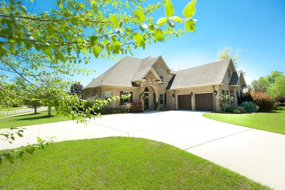 Are you longing to live in an upscale planned commumity with 24-7 guarded access, great neighbors, sidewalks and lots of fun activities?  If so, you've found the right neighborhood and the right home!  As you drive up to this lovely estate you feel it's grandeur and see the attention to detail it offers.  As you step inside you are greeted with soaring ceilings, elaborate lighting and millwork , hand-scraped hardwood flooring, formal dining room with beamed ceiling, large open living room with custom bookshelves and gas fireplace.  The elaborte open concept gourmet kitchen will serve your family and guests well with beautiful custom cabinetry, granite counters, large island, stainless appliances including gas cooktop, double ovens and microwave.  The first floor Master Suite offers privacy with a  hallway leading to the large spacious bedroom and dream closet with floor to ceiling mirror.  The en-suite boasts a jacuzzi tub, large shower, and separate vanities.  The iron ballaster staircase leads you to the second level where the 3 additional bedrooms and 2 baths are located.  Additionally, there is also a large bonus room perfect as a game room, work out room or office.  Outside you have a spacious yard and patio ideal for grilling and entertaining. While living here you get to enjoy all of the of the community amenities including the Lodge, Swimming Pool, Tennis/Basketball Courts, Playground, Fitness Center, 5 miles of Nature Trails, Fishing Pond & yearly activities such as Festivals, Fireworks, Cookouts, 5K Runs and so much more.  Be sure to check out the virtual tour!  LIVE NATURE TRAIL, LOVE NATURE TRAIL, BUY NATURE TRAIL!