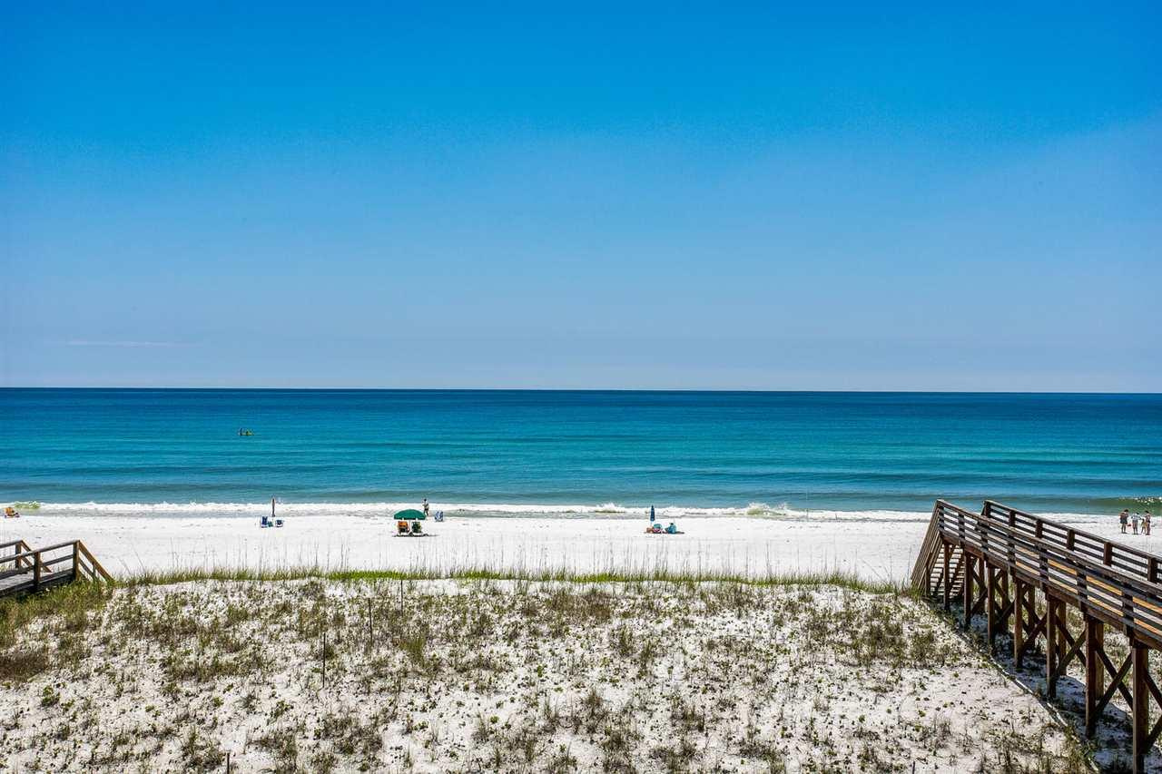 LOOKING FOR THE BEST DEAL ON NAVARRE BEACH?!! Rare opportunity to own a piece of gulf front property! Emerald waters for days. Dolphins in your backyard. The almost 2500 sqft. floor plan boasts 4 bdrms & 4 full bths w/ private fenced side yard for fido. Can sleep 12-16! Bottom Floor - Grandfathered in to have separate living area downstairs. Huge room w/ Private Ensuite. Lrg enough for King bed and pull-out couch. Metal roof, hurricane shutters, hurricane-grade garage door, & TREX composite decking. Beach walkover takes you straight to the gulf from the main deck. Interior featuresgranite kitchen counter-tops, stainless steel appliances, tiled & hardwood floors! Plus a small garage. Seller will give 10K Paint & Sliding Door Credit. NOTHING