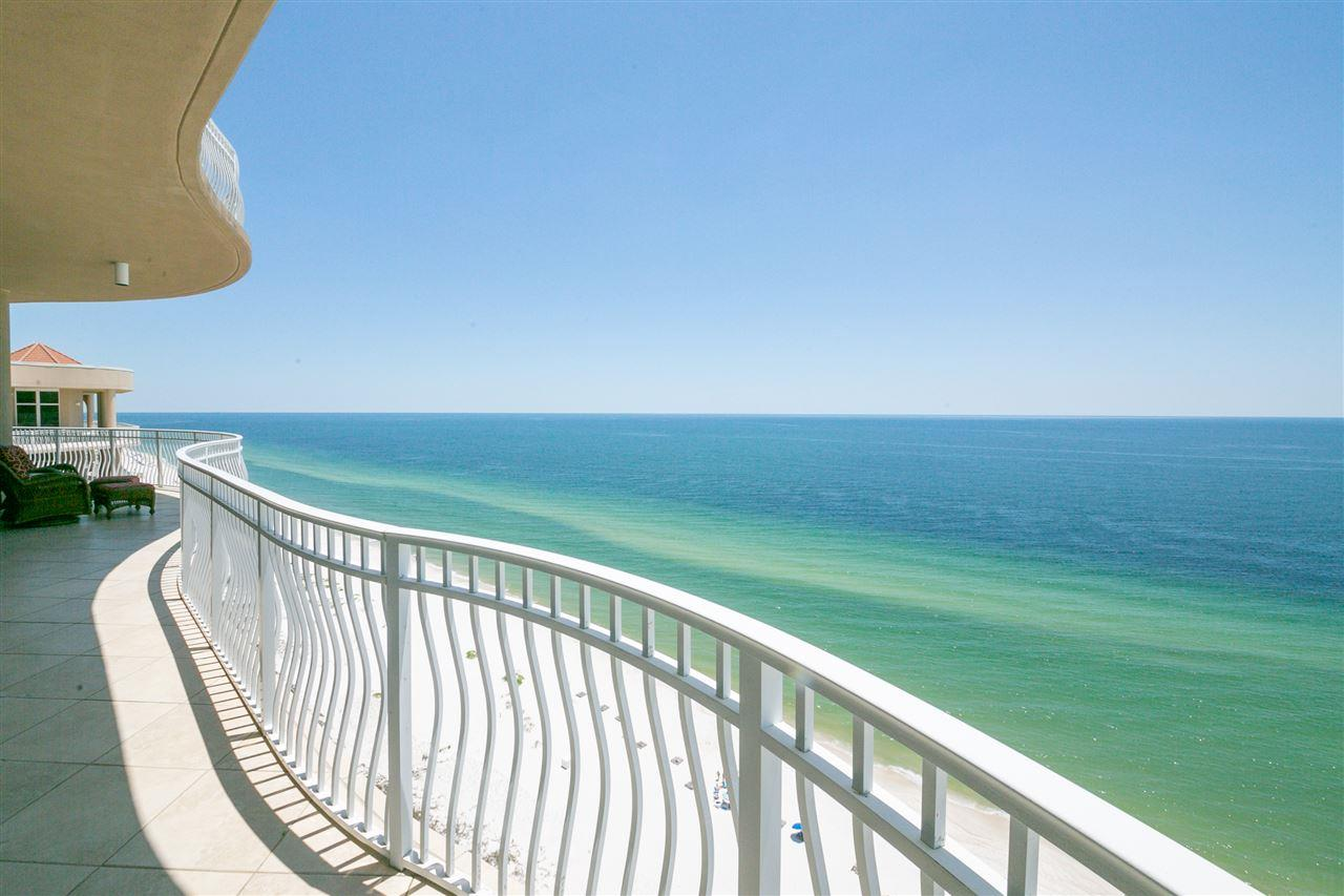 STUNNING PENTHOUSE RESIDENCE, 90-FEET WIDE, WITH DEEDED GARAGE PARKING OFFERING UNSURPASSED, PANORAMIC VIEWS OF PERDIDO KEY!  THIS IMPRESSIVE, BEAUTIFULLY FURNISHED BEACH HOME COMPRISES THE ENTIRE 13TH FLOOR OF LA RIVA'S CENTER TOWER AND BOASTS ONE OF THE BEST FLOOR PLANS ALONG THE GULF COAST. Two Gulf-front master suites and two guest suites (all with en-suite baths) are located at each corner of the floor plan which creates a private retreat for everyone. This open-concept floor plan is an entertainer's delight with multiple seating and dining areas, custom wet bar, and an abundance of outdoor living space that overlooks the emerald-green Gulf waters and inland waterways as well! Every detail in this residence was carefully selected and is sure to impress the most discerning buyer. Highlights include dramatic double-door entry from your private lobby, 11' ceilings, tile flooring in main living areas, gorgeous hardwood flooring in bedrooms, and a stunning mosaic-tiled column that is truly a piece of art gracing the living room. A fabulous, open island Chef's kitchen has premium finishes, upgraded appliances and offers wrap-around bar seating in addition to a breakfast nook overlooking the island to the north. This spacious beach home also provides ample storage space with walk-in closets in all bedrooms, a convenient powder room and a full laundry room with utility sink. LaRiva owners and guests enjoy privacy & uncrowded beaches with only 66 rent-restricted units (1-year minimum lease) and 520' of sugar white sands. La Riva Center Tower also has the best of amenities including a gulf-front outdoor pool, hot tub, steam room and sauna plus indoor heated pool and well-equipped fitness center that offer gorgeous views of the Gulf from the 2nd floor. THIS IS LUXURY BEACHFRONT LIVING AT ITS FINEST!