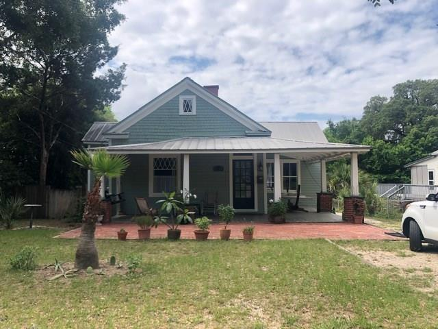 PRICED TO SELL! INCREDIBLE !  This well maintained and renovated 1918 East Hill Cottage is located south of Cervantes between 15th and 16th in the heart of NE Pensacola!  The current owner has resided there for 3 years.  The home was renovated and added on to by the previous owners in 2015.  Entire home was rewired, re-plumbed, new Lenox AC and new roof.  It is move in ready! The foyer entrance is wide leading into the spacious living area open to the upgraded kitchen with eat-in bar, granite & stainless appliances (dishwasher 2018). Two nice areas for a breakfast table or desk overlooking an elevated covered deck! This home has two front bedrooms sharing a full bath with a claw foot tub/shower.  Both rooms have unique fireplace mantles and original wood floors.  The third fireplace is a lovely accent to the living/kitchen areas.  The kitchen is spacious with nice natural light and bright laundry room.  All added on in 2015 along with the master suite.  The master suite has shower only and overlooks covered deck.  The floor plan is excellent providing privacy of master suite separated from other front rooms by laundry room and kitchen.  The integrity of the original home is well preserved with 3 unique fireplaces in two of the bedrooms and living area, (originally shallow coal burning but gas could be added), high ceilings, tall windows, original pine floors and wood siding.  The one car garage was added and has hardy plank siding.  The wide front porch is L shaped with tongue and groove beamed ceiling and brick entry.  The driveway slants slightly downward for easy direct drive into the one gar garage.  The backyard has room for a pool and deck area below.  The exterior back deck is private with nice coastal breezes.  This home is comfortable and solid.   Move in READY and YOU WILL LIVE JUST minutes from two parks, downtown, and beaches!  Call today!~