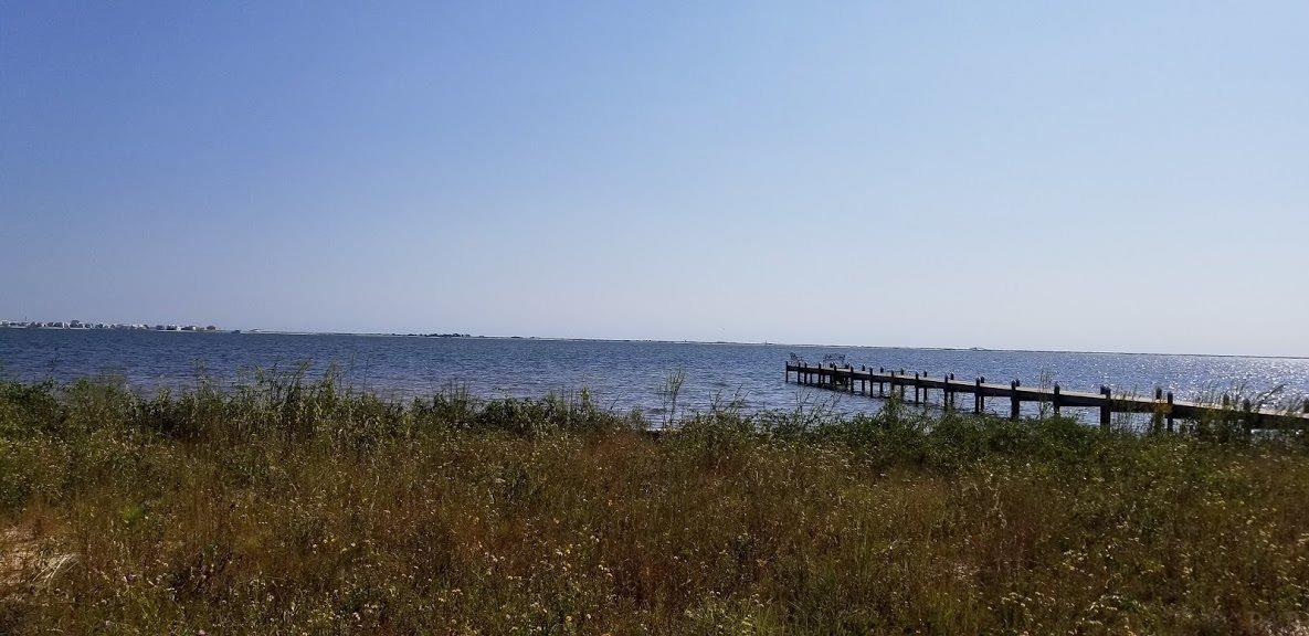 SOUND FRONT LOT UNDER $200,000!!! Located in the upscale waterfront community of Sound Hammock, get ready to build your dream home and live the Salt Life on this beautiful cul-de-sac lot where you can enjoy gorgeous sunrises and sunsets on the Santa Rosa Sound.  The lot has an existing seawall, some oaks and tall pines.  The owner has incurred the expense of the Survey and Geotechnical Engineering Report.  The ammenities of this upscale community offers a Club House, Commuity Pool, Beach Access, Nature Trails, Private Fishing Dock/Pier and Underground Utilities (Natural Gas Available), plus the perks of being in the sought after Santa Rosa School District.  Just bring your plans and builder!