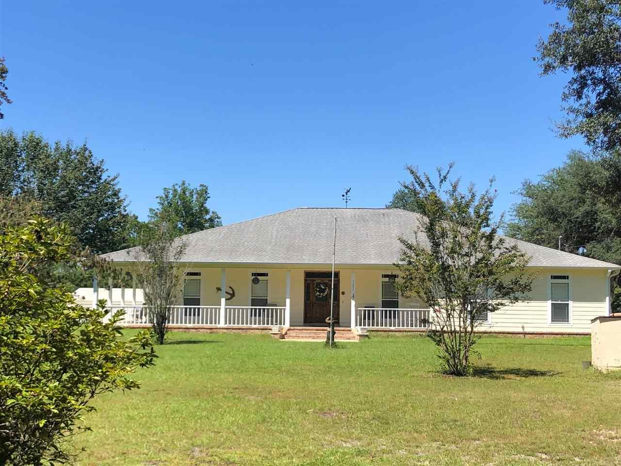282' Feet on deep protected Blackwater River with access to Escambia Bay, Pensacola Bay direct to the Gulf!  This 3 acre parcel is well maintained with this custom built one story, 2,362 sq. ft. home built 2006.  Nice boat trek boat dock (horseshoe shape) with boat lift for a 26-28' boat, a  second slip, lighting, riprap for dock, and a 3 car garage!  This home has nice kitchen / living dining open area with gas fireplace, kitchen window facing large wrap around deck and waterfront.  The master suite is very private with large bathroom, large walk in cedar closet, garden tub, separate shower and tiled floors.  The large master has high ceilings and faces the water.  On the other side of the home are the other bedrooms separated by a full bath.  The study is in the foyer entrance.  Could be used as 4th bedroom.   This home has pine hardwood floors, built ins, security system, lovely covered wrap around porch and nice kitchen /living area w island   This house is on an elevated 3' foundation and has never ever been flooded.  The property has a spacious steel 14 x 18 garage/storage as well as a large open car port housing lawn equipment, work area, etc.  The three car garage is off the kitchen and the entire property is sodded with lovely aged old oak trees with Spanish moss.  There is adjoining property currently for sale as well under a different MLS number on same street with approx.3 acres.  What is so wonderful is this home is very private at the end of Richard Lane on the water and one story!  It is relaxing and minutes from Interstate 10.   Very close driving distance to Milton, Pace and Pensacola is no more than 25 minutes away.  This home is move in ready.!
