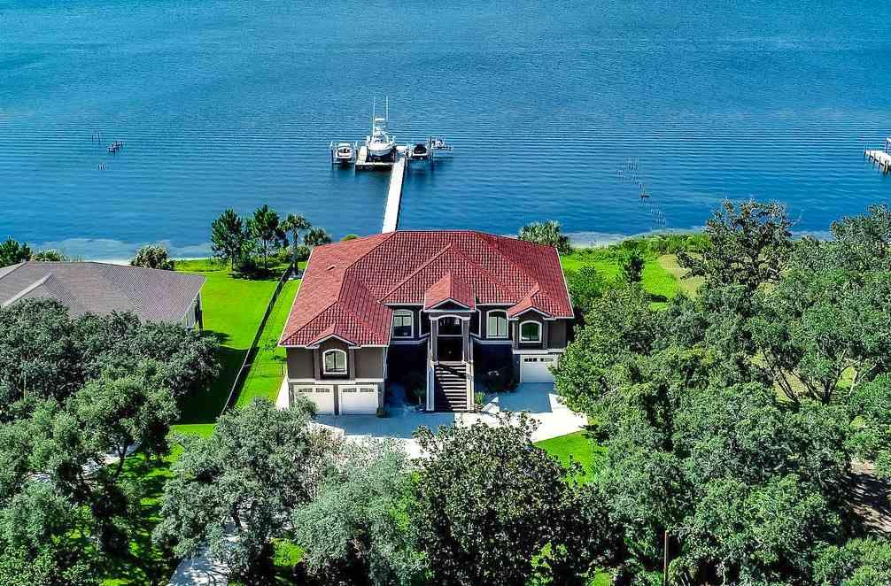 Gated waterfront estate on picturesque Soundside Drive. This executive home is perfect for the boating enthusiast featuring three boat lifts and a double jet ski lift. The New Flow Thru dock system featuring Poly Panel deck sections was installed in 2018. An abundance of outdoor deck space (constructed of TREX decking) overlooks the Santa Rosa Sound. The discriminating buyer will appreciate the vast array of unexpected upgrades. There is an elevator, security system with cameras, 2019 60 kilowatt generator, gated entry, Subzero 132 bottle wine refrigerator, and walk-in pantry with second Subzero refrigerator. Construction upgrades include concrete pilings with a concrete subflooring, stone-coated metal roof, Kolbe impact windows, and two tankless hot water heaters. The gourmet kitchen appliance package is sure to wow the family chef . . . the 65 inch Diva de Provence gas and electric dual oven and cooktop is a focal point. A Subzero refrigerator, warming drawer and Bosch dishwasher complete the package. The Bowman Glass custom light fixture in the dining area is a stunning conversation piece! The entire living area is one level, providing a functional use of space for easy living. The spacious master suite and a large study are on the west side of the home. Two guest suites with private baths are located on the east side of the home. The 3700 square foot garage/storage area affords plenty of space for vehicles, kayaks, water toys, etc. Why wait for new construction? This waterfront dream home features all of the upgrades the savvy buyer expects!