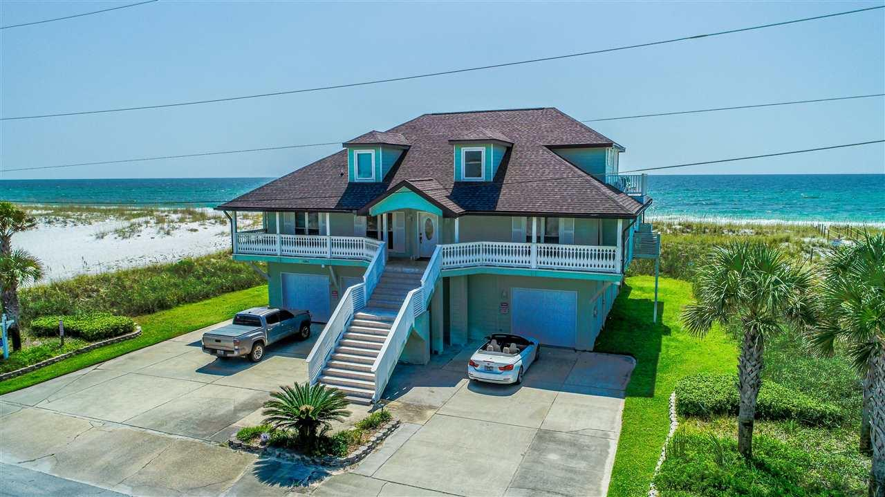 125 ft of Gulf front living at it's finest. Pristine views of the Gulf of Mexico and this beautiful beach home generates over 100 K per year in rental income and is turn key.  Many new recent improvements including a new roof in 2019 & all new painting on the interiors, new kitchen appliances which include gas cooking, double ovens, warming drawer and granite counter tops.  Open spacious living and several dining spaces with a wet bar & a cozy fireplace in the great room. This custom built home offers fabulous views from the 900 square foot deck area and has a private walk over to the beach.  If you have been waiting for the perfect beach home for your family or for investment, you will love this property.  Great location and water frontage. Plenty of storage for cars and all your water toys and space.  Buyer to verify all information including square footage.
