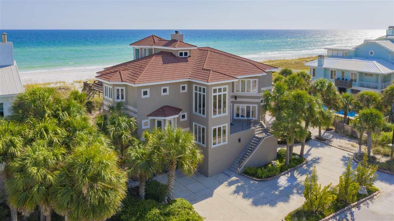 Open House Saturday Sept 5th 10am-1pm. Gorgeous Gulf Front views! Welcome home to Emerald green waters and sugar white sand.  This executive home boasts 100 feet of stunning Gulf frontage. Expansive covered decks on both the first and second living levels offer you an oasis to enjoy sunrises and sunsets on Pensacola Beach.  Your personal walk over, complete with outdoor shower and seating leads you to the waters edge. Inside on the top living level, enjoy water views from the great room, dining rooms and kitchen in open concept living space.  A pantry, wine cooler, gas cook top, granite counter tops and stainless steel appliances complete the cooks kitchen.  On chilly nights, make use of the fireplace.  The spacious master bedroom, master bath with a huge walk in closet allows for privacy as the only bedroom on this floor.  Another flight up you'll find a bonus room full of windows.  Take the elevator down to the first floor you'll find 3 more bedrooms, 2 full bathrooms all freshly painted with new flooring for light and bright living space.  You'll also find a dedicated office complete with built ins, and another bonus room for the family.  The over sized garage fits 3 cars comfortably, with plenty of space for more toys.  Calle Hermosa is one of the most sought after streets on the Beach.  Come Home.