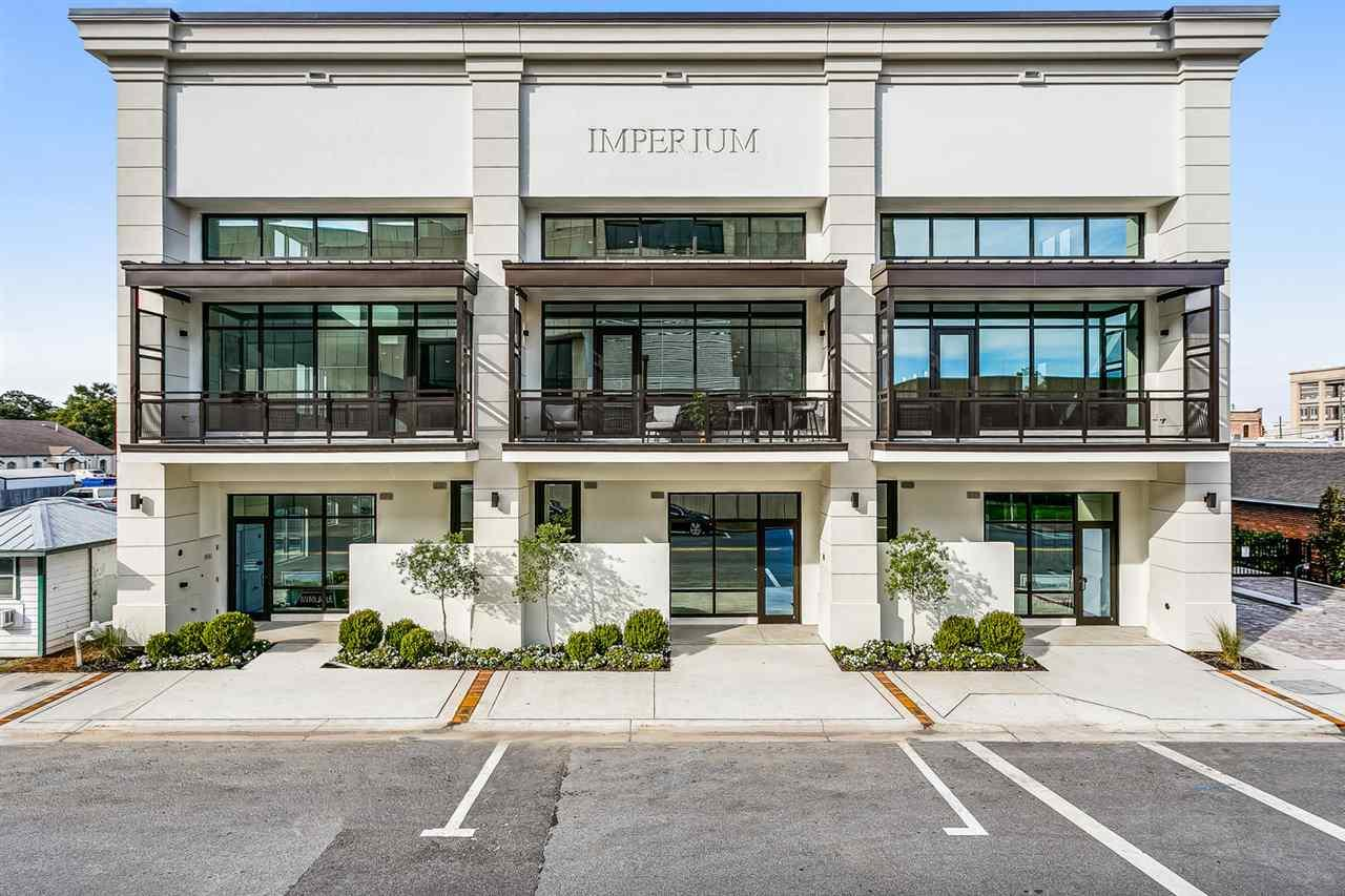 WELCOME to The Imperium! We made it easy for you to view from the safety of your home with a virtual tour and video available for your convenience. This is one of only three residential units, in a small private condo, located in downtown Pensacola.  Steps away from the Community Maritime Park, and a short stroll to Palafox Street, where you will find some of the city's best restaurants, night life and shopping. This three bedroom, three and half bath condominium with thoughtfully crafted selections, features soaring ceilings, reclaimed white pine flooring, with a modern open concept for entertaining and dining. A gorgeous center piece kitchen with classic cool quartz counter tops and an ample island, which highlight the dramatic waterfall