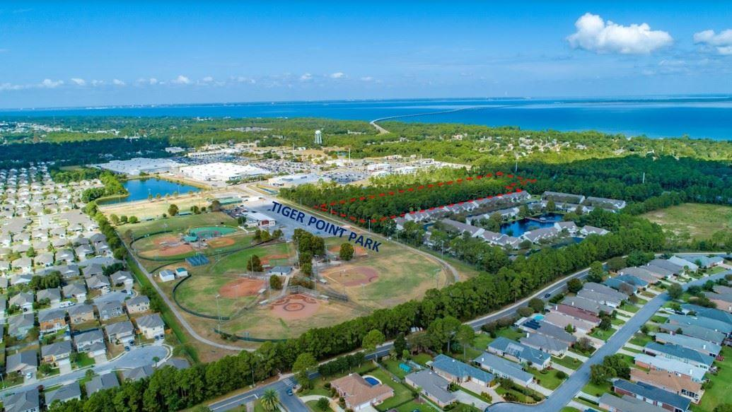 7.60 Acres on Gulf Breeze Pkwy with HCD and R2 Zoning.  Additional 31.60 Acres and 49.87 Acres in Holley By The Sea of County Approved Land for Mitigation in Santa Rosa County.  The 7.06 Acres is comprised of 6.28 acres of R-2 zoning and 1.32 acres of HCD zoning.  Located in the Heart of Tiger Point's dense commercial and housing area, this site is perfect for your commercial/ residential development.