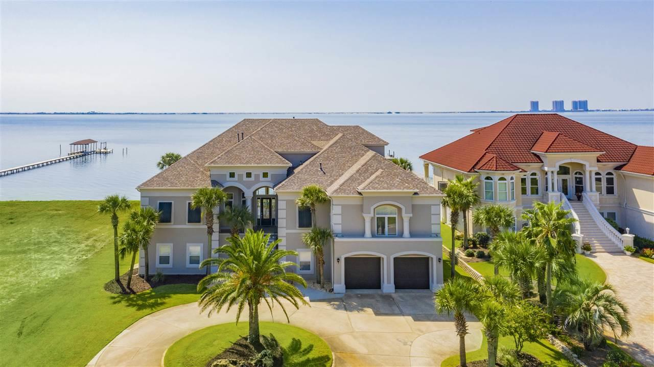 "This regal Sound front home resides on the most desirable street in the golf course community of Tiger Point. Upon arrival, you'll note the grand entryway and beautiful landscaping. The open spacious floor plan encourages entertaining with cascading sliding glass doors, opening up to spectacular Sound views onto the covered balcony. You'll also enjoy the oversized dining room, wet bar and pool room while having guests. The kitchen comes fully equipped with two islands, sub-zero fridge, double wall oven, bread warmer and prep sink. The master suite offers sound views, oversized his & hers walk-in closets and dressing area. Into the master bath with double vanities, soaking tub with a massive shower with 3 shower heads, water closet with a bidet. On the opposite side of the main living floor, you'll find 2 additional bedrooms and 3 full baths and laundry room. The third floor holds a media room with a projection screen (Epson Powerlite Pro Camera), a kitchen and a bedroom with a full bathroom. The office, just off the media room offers amazing floor to ceiling Sound views! Enjoy the convenient elevator to the main living floor, for all your needs. Important notables: brand new within 2 years: New roof, 4 new HVAC units, new pool liner, whole house painted inside and out (exterior with 25 year warranty). SMART HOME with a ""Control 4 System"" which controls the 6 exterior cameras, all home access, sound on all 3 levels, lights, climate control, sprinkler system and fireplace. 2 new exterior staircases with aluminum railing, 2 dehumidifiers on the ground level and 1 in the master bathroom, spray foam insulation in attic and ground floor walls and ceiling, new plumbing and electrical to dock, 2 boat lifts and 1 jet ski lift, landscaping lighting and all new LED recessed lighting. Enjoy panoramic Sound sunsets while lounging in your saltwater pool after an epic day boating! Check out our full video tour on the MLS and YouTube."
