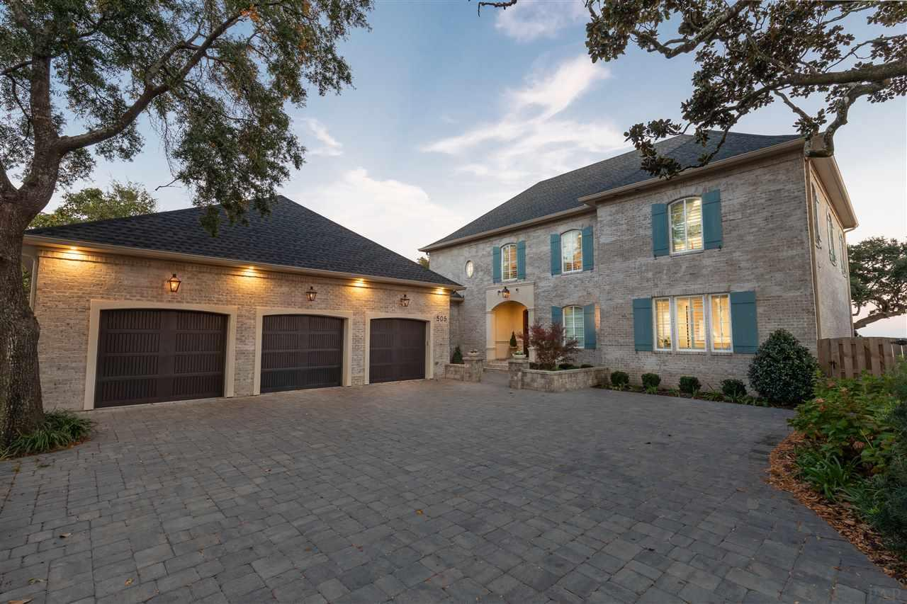 """Elegant, private and coastal, this luxury home is absolutely gorgeous!  Planned in meticulous detail with a design eye for style and outstanding custom quality, this 2017 home is a delight to view as well as live and entertain in. From the mortar-washed brick, board and batten shutters and entry courtyard, it is so impressive! The generous foyer and a long, wide hallway lead to the open living, dining and kitchen area. The panoramic bay views are breathtaking via the 8' Kolbe windows and French doors and are enhanced by the custom distressed ceiling beams and cathedral ceiling. Note the kitchen focal point: a metal artisan created the 5' Zinc Range Hood over the 4' Wolf double stove that complements the Carrara marble counters, oversized island and backsplash perfectly. The dining area table can easily seat 10+. In the spacious living room, Carrara marble surrounds the 42"""" gas log fireplace.The bar area with an ice maker and beverage fridge is adjacent to the summer kitchen. The abundant storage is evident by the room sized butlers pantry with sink, microwave, wine storage and numerous cabinets. The private office has two closets and is conveniently located. The serene, waterfront master suite features an unsurpassed bath area, 3 large quartz vanity areas, quartz floors, a big steam shower, deep soaking tub, and 2 private toilets. The 16'x13' closet is fabulous in both space and layout with glass front cabinets, shelves, racks for 100+ pairs of shoes, and drawers in a huge center island. Upstairs, a large waterfront bonus room with a walk in closet/room, could be a media room, 2nd master, etc., your choice. The two bedrooms are private and comfortable and share an oversized bath, with quartz shower, double vanity. The open area at the top of the stairs invites table games, exercise, reading, etc. You will see this extraordinary house is extraordinary in quality, beauty, architectural design and lifestyle comfort. (See feature sheet at end of photos)"""