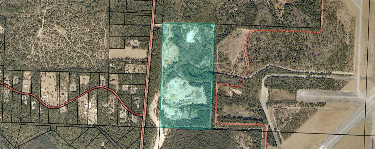 This property contains approximately 81.87(+/-) acres of land that is utilized as an existing Borrow Pit and is located just N of NAS Whiting Field entrance and has a Borrow Pit with Brown Top, Red Clay, White Sand - Fenced all around - There's 2 parcels with this property (parcel Id's 34-3N-28-0000-00400-0000 and 33-3N-28-0000-00539-0000 and there's a metal 2400sf Building with 1582sf Warehouse Space and 818sf Office Space to handle the operations of a Borrow Pit.