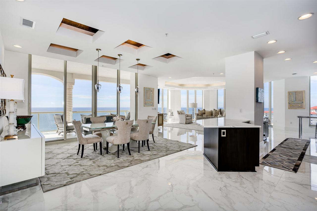 """Panoramic views of the emerald green gulf waters from this fabulous Beach Club Sky Home. Step into this twentieth floor west end unit and be """"wowed"""". Enjoy views of the entire island from the 685 feet of balcony spaces that take advantage of southern gulf views, sunrises, and sunsets. The northern balcony boasts sound views, bustling boating activity and sparkling night lights of the area. The Beach Club amenity package is sure to please! Enjoy the fabulous spa, fitness center, indoor pool, beach front pool and spa. The interior finishes are not standard condominium fare. The tasteful array of lighting features artisan handblown glass and updated designer lighting fixtures. Stunning skid proof 36 inch Italian tile was recently installed throughout giving this beach home a contemporary coastal flare. A gourmet kitchen with expansive marble counter space offers custom cabinets, a walk-in butler's pantry, stainless designer appliances (including free standing ice maker, wine cooler, Subzero refrigerator). Other features include floor to ceiling windows and sliders with electric solar shades, fresh paint throughout, LED recessed lighting, and two covered parking places! The gulf front Master Bath includes Dry Sauna, Walk-in Double Shower, Oversized Round Whirlpool Tub, and Bidet. Master Bedroom includes two oversized walk-in Closets with custom built-ins. Each Guest Bedroom has full Bath with tub and shower. The gulf balcony includes an electric grill and all glass railing This one-of-a-kind beach home provides all of the living space and luxury of waterfront living without the maintenance of keeping up a waterfront home!"""