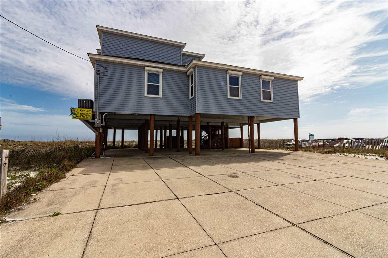GULF FRONT WITH SUNRISE, SUNSET, GULF AND SOUND VIEWS! Primary residence, Vacation home or Investment property.  Gulf front great room with pine wood cathedral ceilings and laminate wood flooring. Gulf front kitchen with two dining areas and breakfast bar. Three master bedrooms with private bathrooms and sound views. Two bedrooms on second floor with bathroom and sound views. Oversized covered parking and outdoor shower. Automatic hurricane shutters. Come and enjoy your piece of paradise.